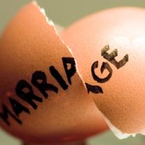 A broken egg shell, split through the word marriage