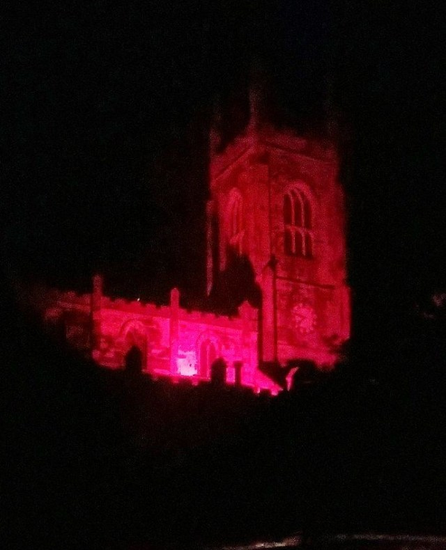 Holy Trinity Huddersfield church building with the tower illumimated red during the celebrations of being open 200 years