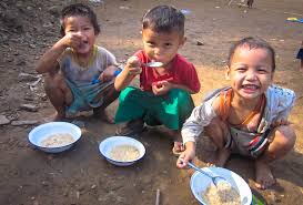 Three hungry Thai children.