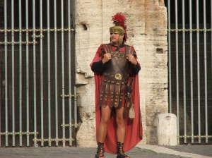 A Roman centurion stands guard at the Colosseum.