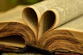 An old Bible with pages turned inwards to form a heart.