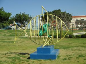 A playground climbing frame in the shape of a fish.