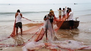 Fishermen preparing the nets for dragnet fishing.