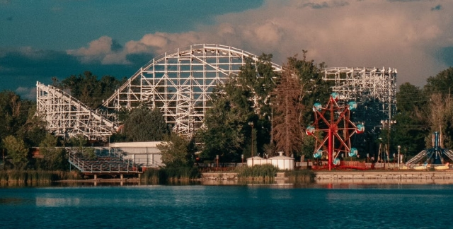 A theme park containing a rollercoaster.