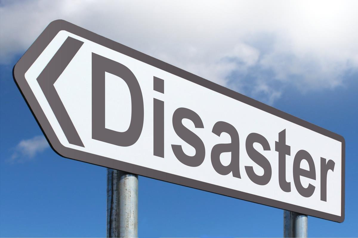 A road signpost containing the word Disaster.