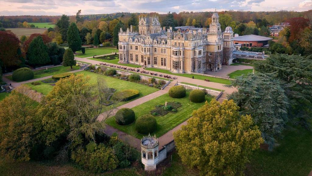 An aerial view of Thoresby Hall, showing autumnal colours in the surrounding woodland.