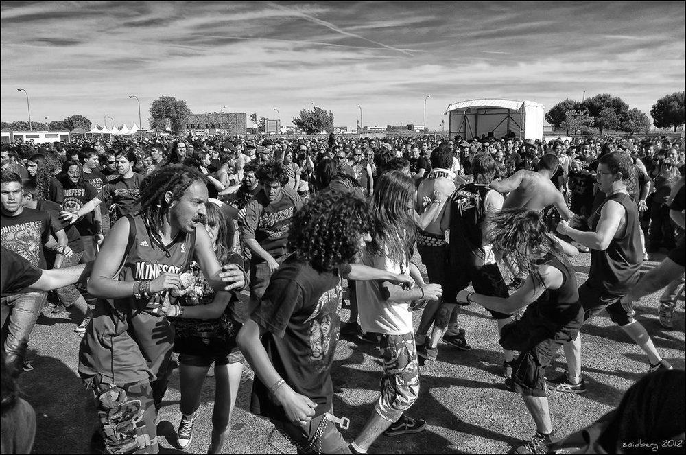 Heavy metal music fans dancing.