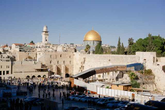 The city of Jerusalem, showing the wailing wall and the Dome of the Rock mosque near the Temple Mount.