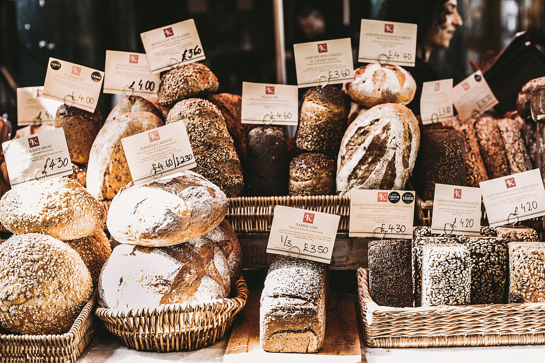 A market bread stall showing an assortment of different loaves for sale.