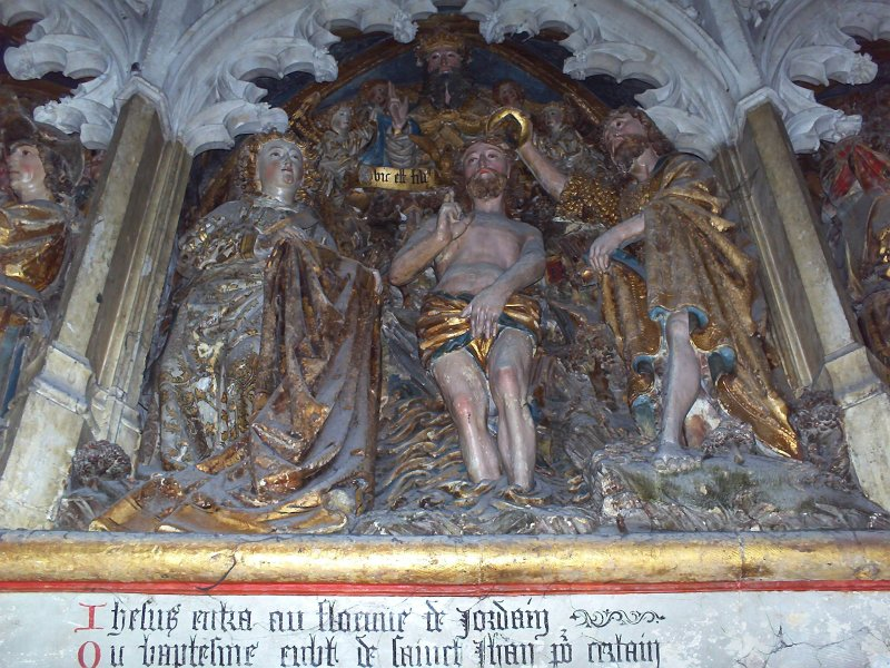 A church statue showing John the Baptist pouring water over a man in a loin clorh.
