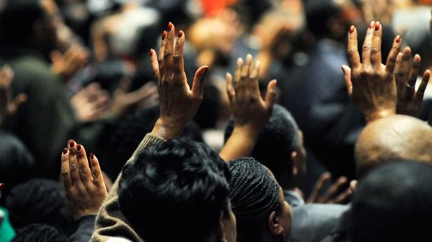 Hands held high in exuberant praise to God.