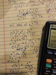 A calculator sits on a page of algebraic equations.