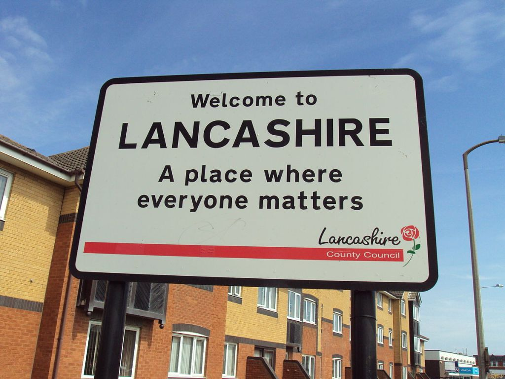 """A road sign saying, """"Welcome to Lancashire, a place where everyone matters."""""""