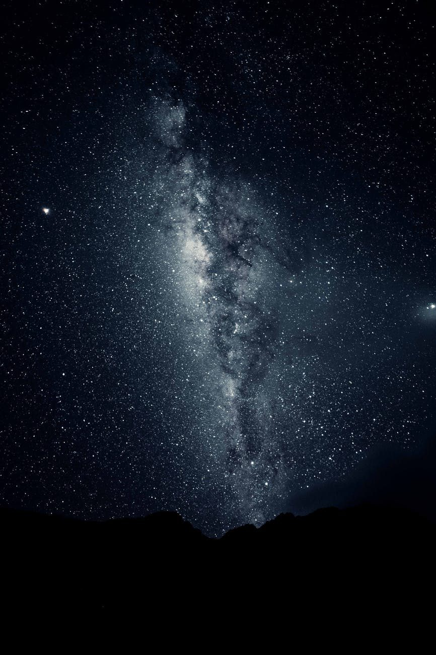 silhouette-of-mountain-under-starry-night